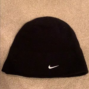 Black Nike golf hat. One size fits all.